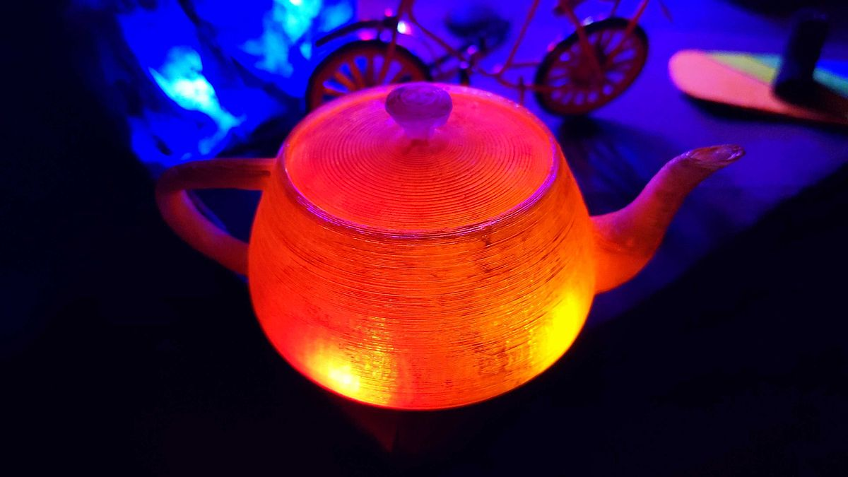 Photograph of an illuminated Utah teapott