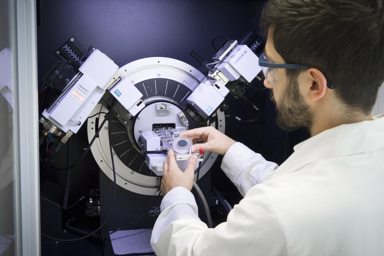 A scientist conducts a structure determination on an x-ray diffractometer